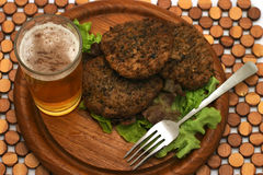 Hamburger with beer. On wooden plate Stock Photography