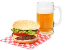Hamburger and beer. On wrapping paper Stock Images