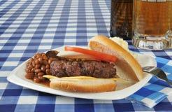 Hamburger and beer Stock Image