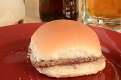 Hamburger and beer Stock Images