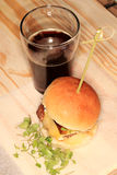 Hamburger and beer Stock Photos