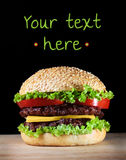Hamburger on black. With copy-space Stock Photography