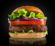 Hamburger on black background Royalty Free Stock Images