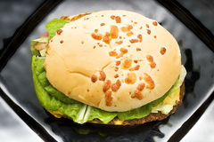 Hamburger on Black Plate Royalty Free Stock Photography