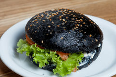 Hamburger black with salmon.  Stock Photo
