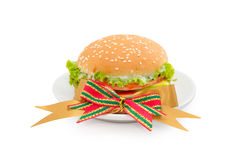 Hamburger with bologna and tomato on white dish Stock Photos