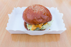 Hamburger in box on wooden table Background. Hamburger in white box on wooden table Background Stock Photos