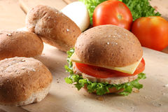 Hamburger, breads and fruits Stock Images
