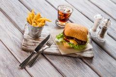 Hamburger and bucket of fries. Royalty Free Stock Image