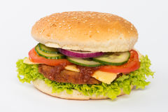 Hamburger in bun with salad. Hamburger with beef and cheese in a bun with bed of lettuce, sliced tomato, cucumber and onion isolated on white background stock images