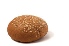Hamburger bun with sesame seeds isolated on a white background. Hamburger bun with sesame seeds isolated on white background Stock Image