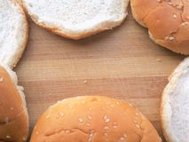 Hamburger buns frame on wooden background Stock Photography