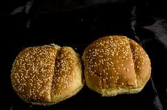 Hamburger buns with lot`s of seed`s. Bread is a staple food prepared from a dough of flour and water, usually by baking. Throughout recorded history it has been stock photos