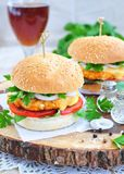 Hamburger , burger, cheeseburger with grilled beef, cheese, and vegetables Royalty Free Stock Images