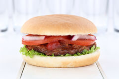 Hamburger burger fresh tomatoes lettuce Royalty Free Stock Photos