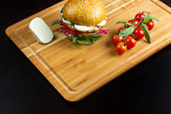 Hamburger with cheese on a bamboo dash. Stock Image