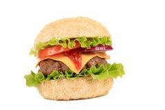 Hamburger with cheese and ketchup. Stock Photos