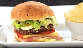 Hamburger with cheese and tomato Stock Photography