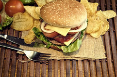 Hamburger with cheese, tomato, onion and lettuce Stock Photo