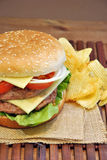 Hamburger with cheese, tomato, onion and lettuce Stock Images