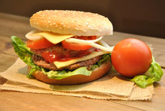 Hamburger with cheese, tomato, onion and lettuce Stock Photography