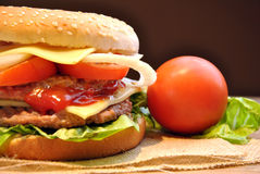 Hamburger with cheese, tomato, onion and lettuce Stock Image