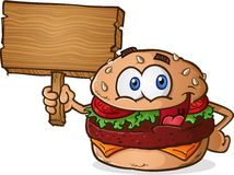 Hamburger Cheeseburger Cartoon Character Holding a Wooden Sign. A happy smiling cheeseburger cartoon character holding a blank wooden sign Royalty Free Stock Photography