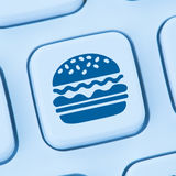 Hamburger cheeseburger fast food ordering online order delivery Royalty Free Stock Photo
