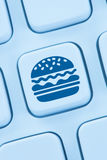 Hamburger cheeseburger fast food ordering online order delivery Stock Image