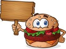 Hamburger-Cheeseburger-Zeichentrickfilm-Figur, die ein Holzschild hält Lizenzfreie Stockfotografie