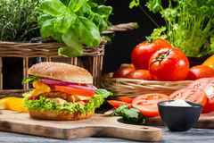 Hamburger with chicken, vegetables fresh herbs Stock Photography