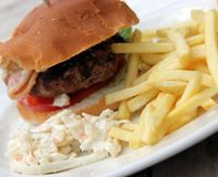 Hamburger and chips and coleslaw Stock Images
