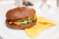 Hamburger with chips in a fast food restaurant Royalty Free Stock Photography