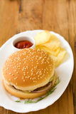 Hamburger with chips Stock Images