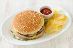 Hamburger with chips and sauce Royalty Free Stock Images