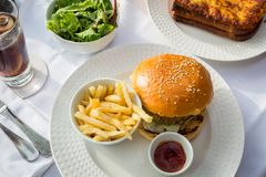 Hamburger and chips served in a French cafe Royalty Free Stock Photo