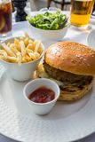 Hamburger and chips served in a French cafe stock photography