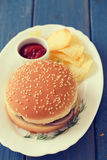 Hamburger with chips and tomato sauce Royalty Free Stock Image