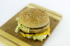 Hamburger on a chopping table. Against a white background Stock Image