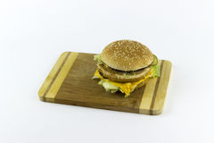 Hamburger on a chopping table. Against a white background Stock Photography