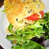 Hamburger with ciabatta bread and salad Stock Images
