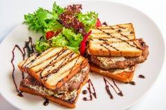 Hamburger closeup with bacon and cheese sauce, Stock Photo