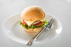 Hamburger com forquilha Foto de Stock Royalty Free