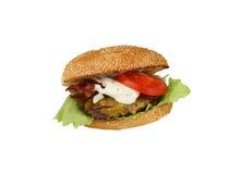 Hamburger com queijo Cheddar um bacon Fotografia de Stock