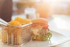 Hamburger con il tramonto Fotografia Stock