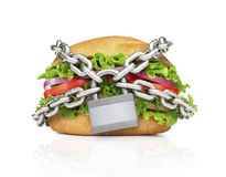 Hamburger constrained with chain. Stock Images