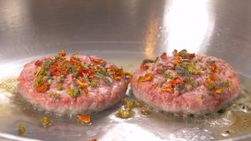 Hamburger cutlet frying on pan. Natural meet loaf pieces cooking in the kitchen. stock footage