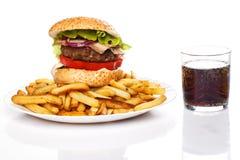 Hamburger, dłoniaki i kola, fotografia stock