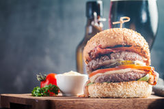 Hamburger and dark beer in vintage style Stock Photo