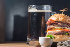 Hamburger and dark beer in vintage style Stock Photography
